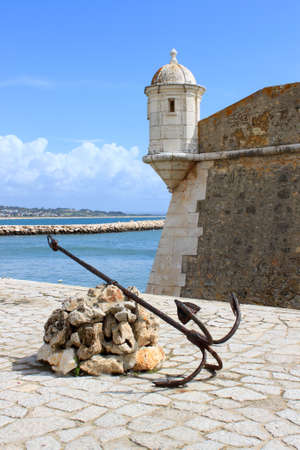 17 century fortress with an anchor  on the seafront of Lagos, Algarve, Portugal called Forte Ponta da Bandeira