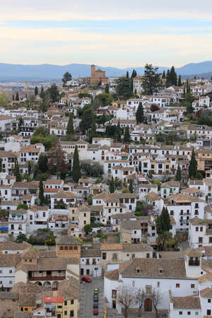 granada: Cluster of houses and rooftops along the hillside in the Albaicin area of Granada, Spain Stock Photo