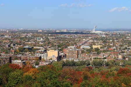olympic stadium: Panoramic view of North Montreal, Quebec, Canada during Autumn or Fall season with Olympic Stadium in the background  Editorial