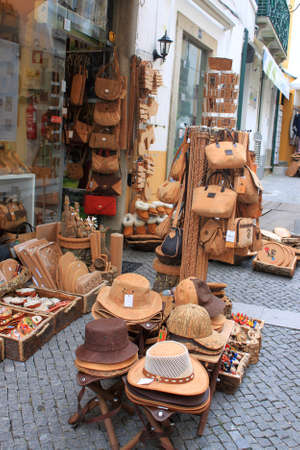 exporter: EVORA,PORTUGAL-APRIL18,2013: Beautiful crafted cork goods outside the storefronts along the busiest tourism souvevir shops in Evora selling one of Portugals biggest exporter, cork items in Evora, Portugal on April 18, 2013 Editorial
