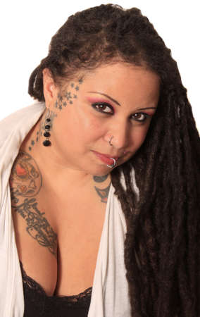 tattoed: Beautiful ethnic curvaceous woman with long dreadlocks, tattoos and piercings, on a white  Stock Photo
