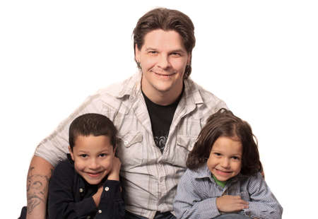 single father: Tattoed and pierced father sitting with his two sons on a white background