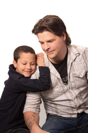 handome: Handome father with tattoos and piercings and his son leaning on him