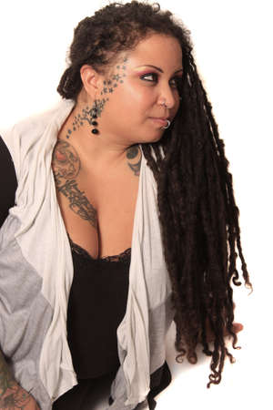 tattoed: Beautiful ethnic curvaceous woman with long dreadlocks, tattoos and piercings, on a white background