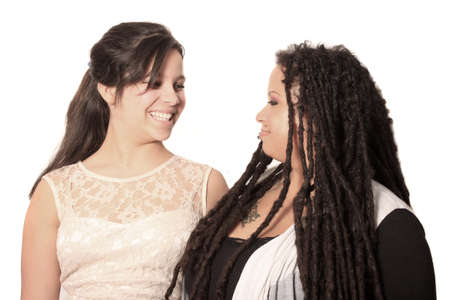 Mother and daughter look at each other lovingly on a white  Stock Photo