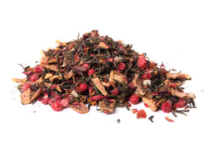 Pile of dried loose berry blossom tea  with leaves ready to steep and brew on a white background Stock Photo