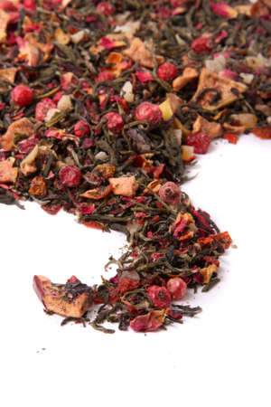 dehydrated: Pile of dried loose berry blossom tea  with green leaves ready to steep and brew on a white background