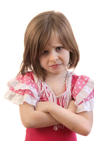 Upset little young girl with arms crossed in disappointment