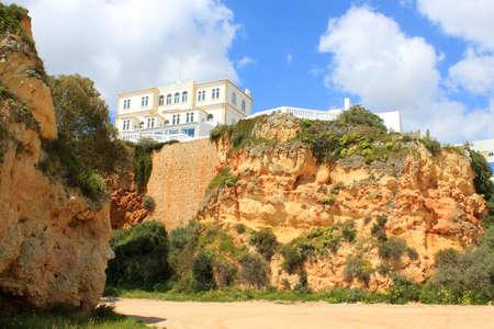 rocha: House or resort on the top of an ochre cliff in Praia da Rocha, Algarve Portugal