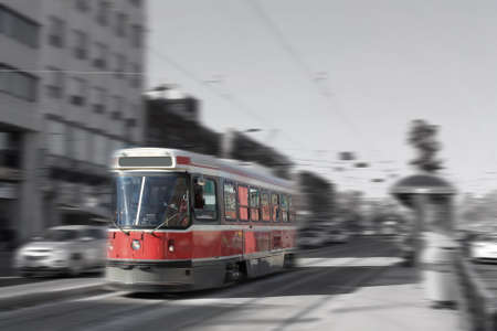 streetcar: Streetcar transportation in downtown Toronto, Canada with motion blur in black and white and color Stock Photo