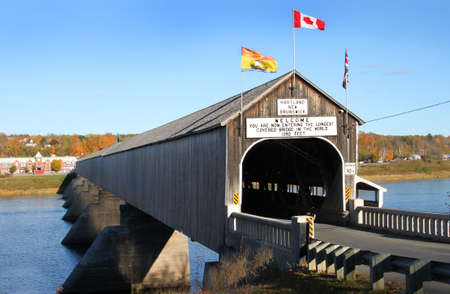 longest: The longest wooden covered bridge in the world located in Hartland, New Brunwick, Canada in Autumn time Stock Photo
