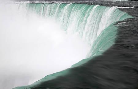 rushing: Close up or roaring water rushing over the cliff of Horseshoe Falls in Niagara Falls, Ontario, Canada