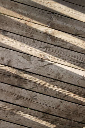 slits: Slits of sunlight on wooden floorboards creating an abstract background