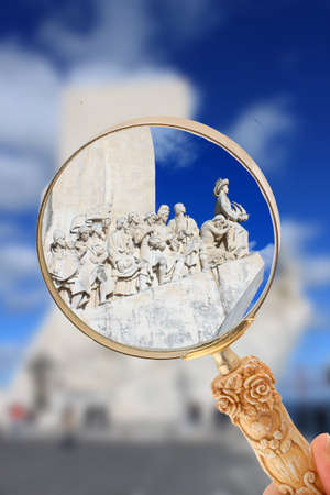 Magnifying glass focusing in on one of the most popular tourist attraction, The Monument to the Discoveries in Belem, Lisbon, Portugal Stock Photo