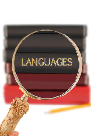 linguistic: Magnifying glass or loop looking on an educational subject - Languages Stock Photo