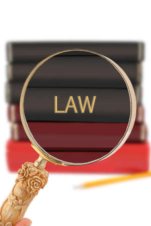 educational subject: Magnifying glass or loop looking on an educational university subject - Law