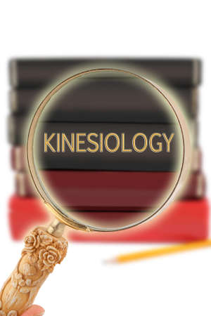 föremål: Magnifying glass or loop looking on an educational subject - Kinesiology,  excercise and sport science