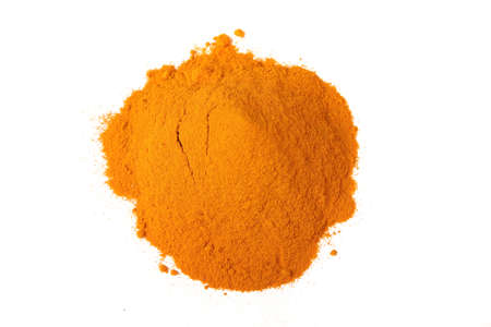 curcumin: A pile of the colorful spice, ground turmeric or curcumin on a white background