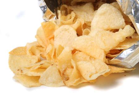 spilling: Bag of kettle chips spilling over on a white background