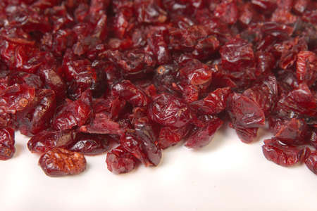 dehydrated: Pile of dried red cranberries on a white background Stock Photo