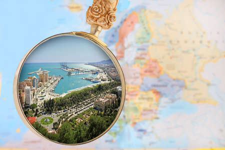european map: Looking in on Malaga Spain with a magnifying glass or loop with European map in the background