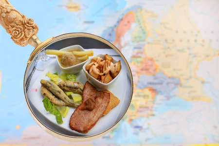 european map: Looking in on food of the world showing tapas of Spain with a magnifying glass or loop with European map in the background Stock Photo