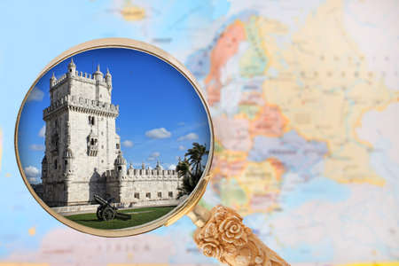 european map: Looking in on Torre de Belem  a monument in  Portugal with a magnifying glass or loop with European map in the background