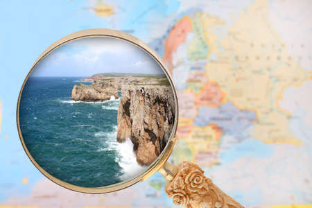 coastal erosion: Looking in on Cabo de Sao Vicente, Portugal with European map in the background