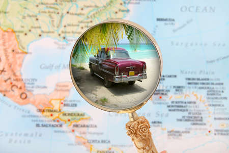 old fashioned car: Looking in on a Cuban beach with old fashioned car with blurred Caribbean map in the background