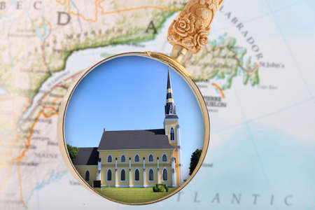 locating: Looking in on a rural church in Atlantic Canada with map in background