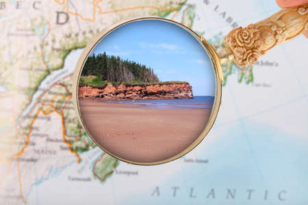 locating: Looking in on the Coastal features showing red sand in Prince Edward Island, Canada Stock Photo