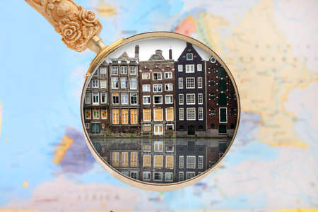 gabled houses: Looking in on Amsterdam, Holland or Netherlands with blurred European map in the background