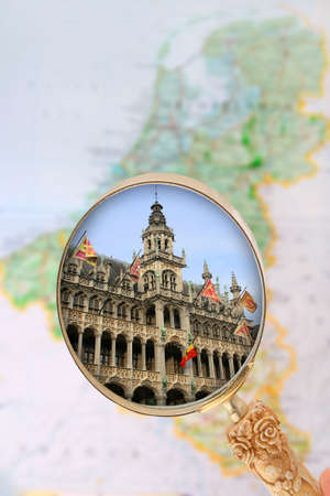 place of research: Looking in on Grand Place, Brussels, Belgium with map blurred in the background Stock Photo