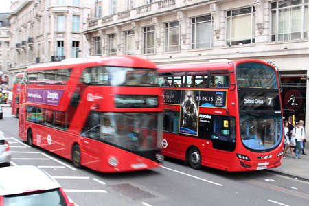 speeding: LONDON,ENGLAND,June 17, 2015: Double Decker buses speeding through the busy streets of London England on June 17, 2015