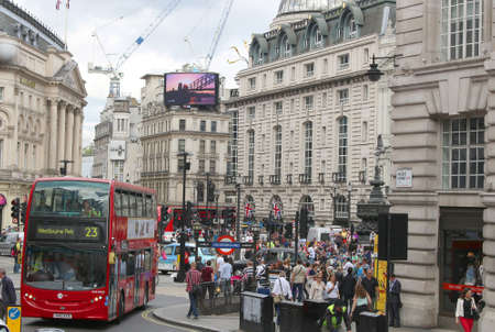 piccadilly: LONDON,ENGLAND,June 17, 2015: Busy streets with people and traffic in Piccadilly  Circus area in London, England in June 17, 2015 Editorial