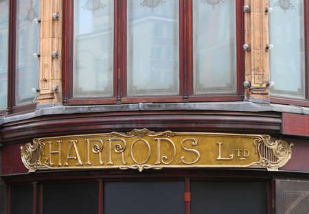 harrods: LONDON,ENGLAND, June 17, 2015: Sign above entrace to Harrods department store in London, England, June 17, 2015 Editorial