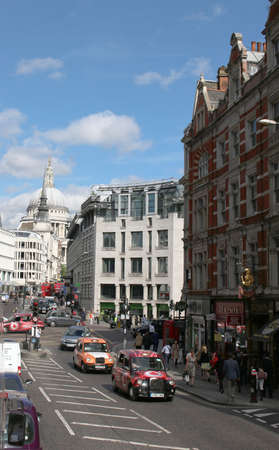 st pauls: LONDON,ENGLAND, June 19, 2015: Busy street with traffic and pedestrians with St. Pauls Cathedral in the background in London England on June 19, 2015