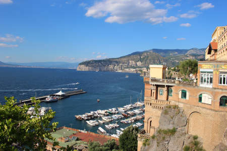sorrento: Ocean view of coastal features of Italy in Sorrento with cliffside houses and boat marina