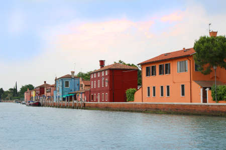 fishermen's: Colorful fishermens houses along the shore  of the Italian island of Burano Stock Photo