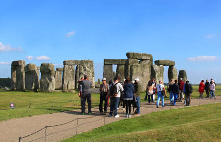 stonehenge: WILTSHIRE,UNITED KINGDOM, June 19, 2015: People visiting Stonehenge on the lush countryside of England in Wiltshire