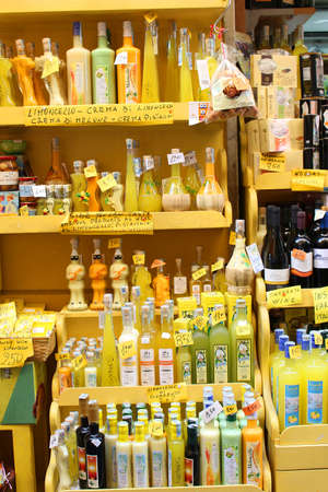 sorrento: SORRENTO, ITALY - JUNE 26, 2015: A colorful display outside a store in Sorrento,  selling different liquors like limoncello made from lemons famous in Southern Italy