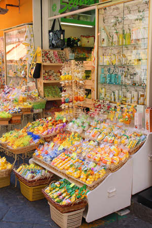 sorrento: SORRENTO, ITALY - JUNE 26, 2015: A colorful display outside a store in Sorrento,  selling different citrus soaps and souvenirs made from lemons famous in Southern Italy
