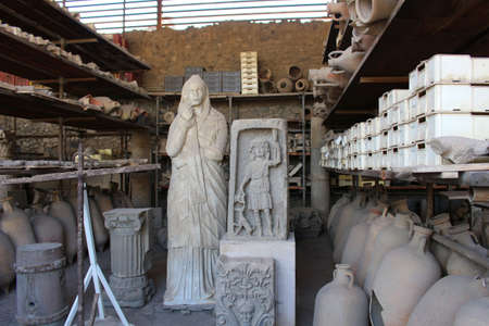 artifacts: POMPEII, ITALY, JUNE 26, 2015: Ancient artifacts found in the ruins of the old city of Pompeii, Italy Editorial