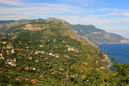 mountainous: Houses and greenery along the mountainous costline of the Amalfi Coast in Italy Stock Photo