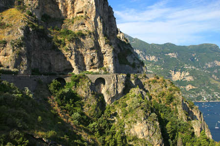 dangerous road: Dangerous road along the side of the cliffs of the Amalfi coast in Italy