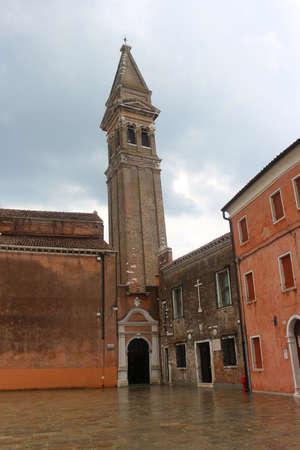 tilting: Tilting tower of the church in Burano, Veneto, Italy