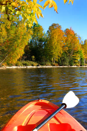 maritimes: Kayak on the river with trees in the background in early Autumn season in New Brunswick, The Maritimes in Canada Stock Photo