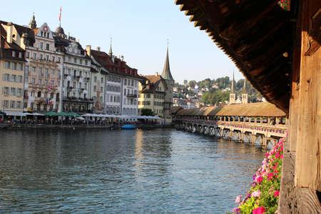june 25: LUCERNE, SWITZERLAND, JUNE 25, 2015: Wooden covered, Chapel Bridge located in Lucerne, Switzerland in early evening