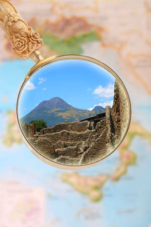 mount: Magnifying glass looking in on Pompeii with Mount Vesuvius in the background