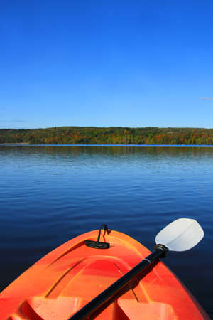 maritimes: Kayak on the Saint John River in early Autumn season in New Brunswick, The Maritimes in Canada. Focus on front of kayak